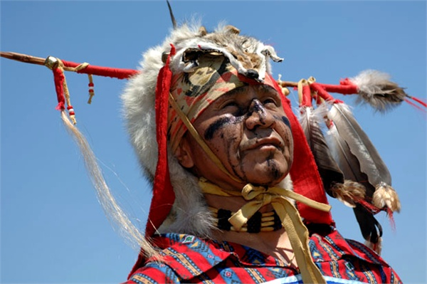 Jul 10, 2020 - Vancouver, British Columbia, Canada - Native Indian man, dressed in full regalia, during the annual Squamish Nation Pow Wow. A modern Pow Wow is a historically traditional event where Native American people compete in dancing and singing, and non-Native American people meet to honor American Indian culture. There is generally dancing, as well as singing, competition in various categories, often with significant prize money awarded. Pow Wows vary in length from one day session of 5 to 6 hours to three days. Major Pow Wows or Pow Wows called for a special occasion can be up to one week long. The Squamish Nation Pow Wow lasts for three days.